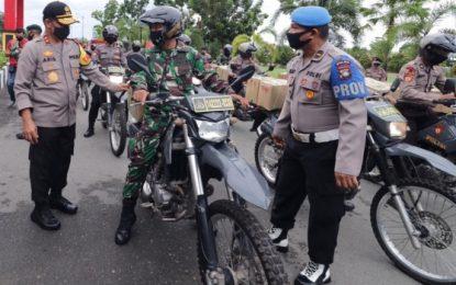 Peduli Covid –19, TNI-Polri bersama Yayasan Budha Tzu Chi Berikan Bantuan Paket Sembako